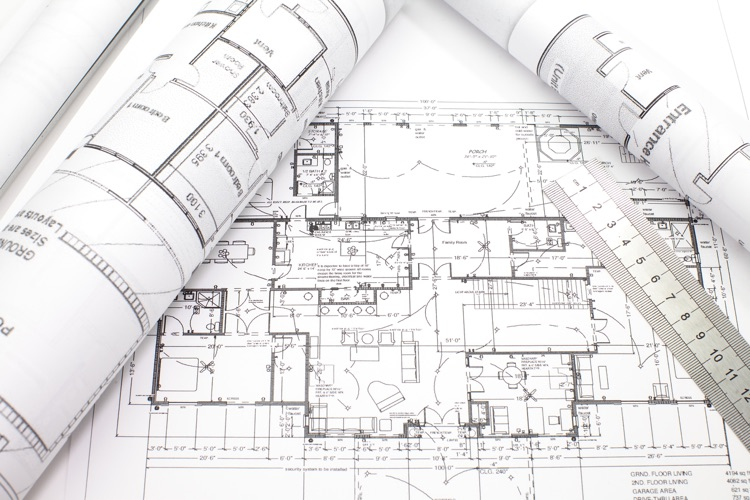 photo of Architecture plan and rolls of blueprints